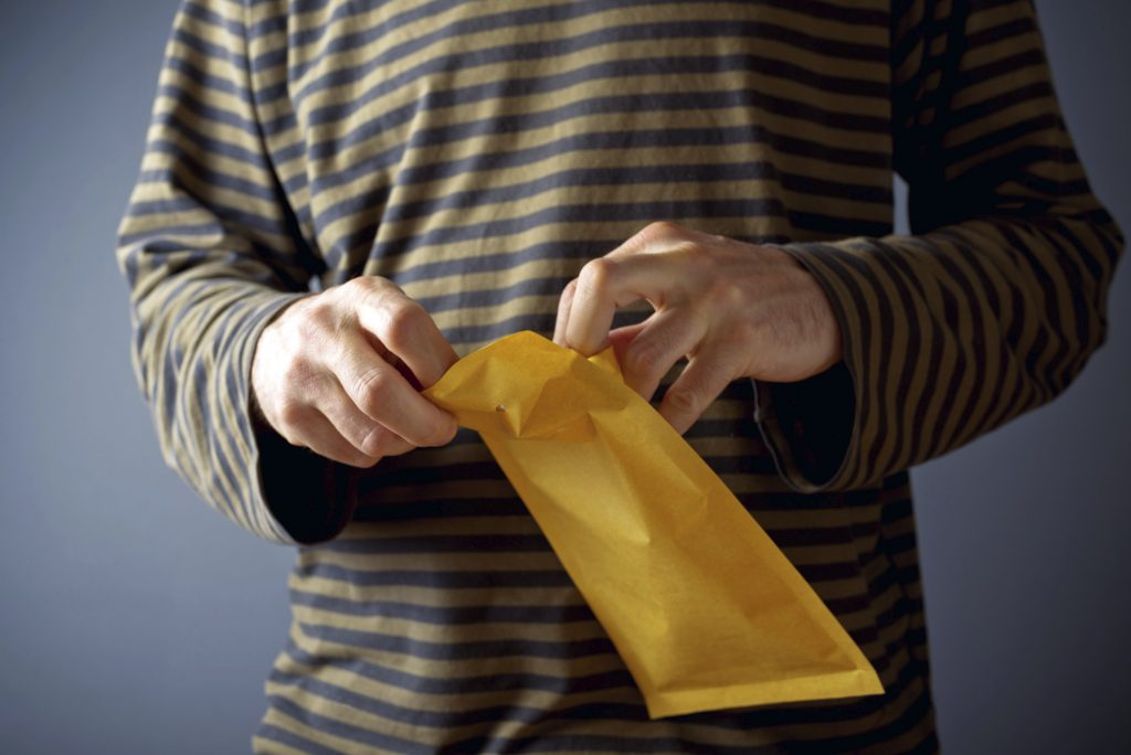 Man opening mail envelope