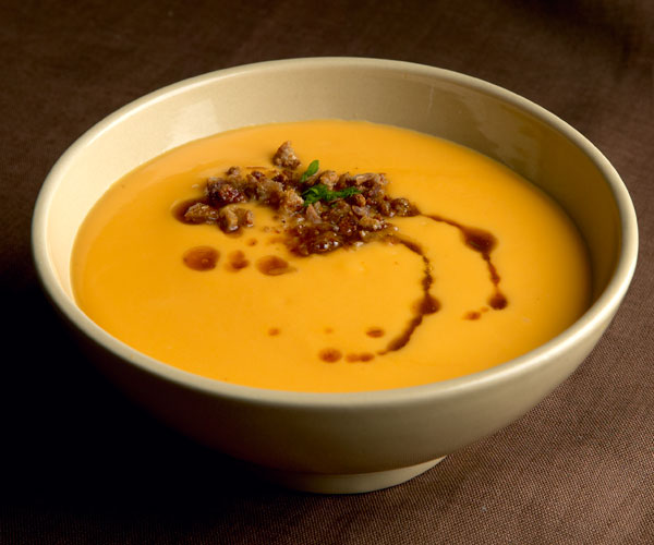 Roasted Sweet Potato Soup with Sorghum Butter and Duck Cracklings